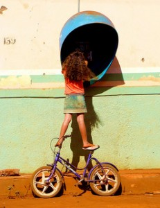 Girl standing on bike