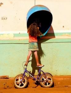 Girl standing on bike