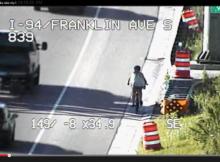 girl bikes on freeway